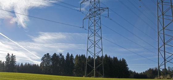 The picture shows power transmission lines in a landscape.